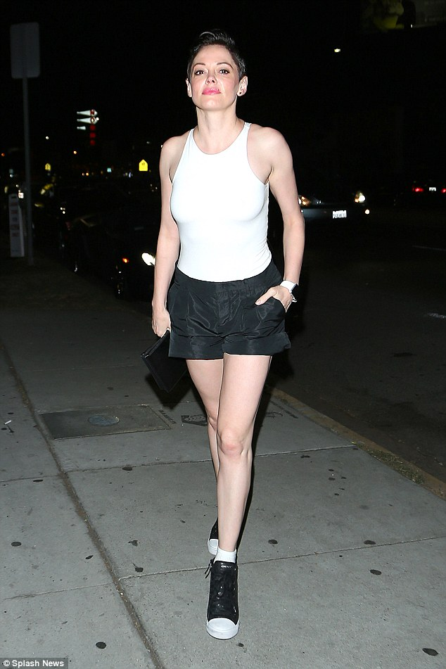 Monochrome miss: Rose McGown put on a flesh-flashing display in an ultra-tight white vest top and tailored black shorts as she headed out in Los Angeles, California, on Friday evening