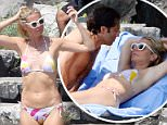 12.JULY.2015 - POSITANO - ITALY * EXCLUSIVE PICTURES AVAILABLE FOR UK USA AND AUSTRALIA ONLY * AMERICAN ACTRESS GWYNETH PALTROW AND HER BOYFRIEND BRAD FALCHUK SEEN ENJOYING A HOLIDAY IN ITALY. THE COUPLE WERE SEEN SUNBATHING ON THE ROCKS AND DIVING INTO THE SEA FOR A SWIM. BYLINE MUST READ : XPOSUREPHOTOS.COM ***UK CLIENTS - PICTURES CONTAINING CHILDREN PLEASE PIXELATE FACE PRIOR TO PUBLICATION *** **UK CLIENTS MUST CALL PRIOR TO TV OR ONLINE USAGE PLEASE TELEPHONE 44 208 370 0291**