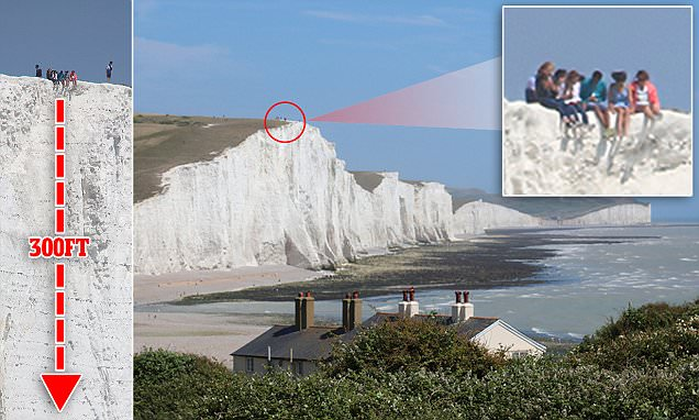 Teenagers dangle legs over Seven Sisters cliffs edge above 300ft drop