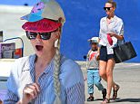 Picture Shows: Jackson Theron, Charlize Theron  July 10, 2015    Actress and proud mom Charlize Theron was spotted wearing a 'Frozen' wig while goofing around during lunch with her son Jackson at a Mexican seafood restaurant in Silverlake, California.    Exclusive - All Round  UK RIGHTS ONLY    Pictures by : FameFlynet UK © 2015  Tel : +44 (0)20 3551 5049  Email : info@fameflynet.uk.com