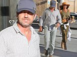 EXCLUSIVE TO INF. June 13, 2015: Gerard Butler and girlfriend  Morgan Brown getting coffee in Los Angeles, CA.  After coffee, the couple headed straight to a waiting car. Mandatory Credit: INFphoto.com Ref.: inf-00