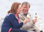 14.7.15..... CORONATION STREETS ROY CROPPER (PLAYED BY DAVID NEILSON) AND THE NEW LOVE OF HIS LIFE CATHY MATTHEWS (PLAYED BY MELANIE HILL) ENJOY AN ICE CREAM ON THE PIER IN BLACKPOOL.