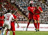 Liverpool player Mamado Sakho (2nd R) shoots to score a goal against the Thai all-star team during their friendly soccer match at Ratchamangkala Stadium in Bangkok, Thailand, July 14, 2015. REUTERS/Athit Perawongmetha