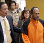 FILE - In this Tuesday, July 7, 2015 file photo, Juan Francisco Lopez-Sanchez, right, is lead into the courtroom by San Francisco Public Defender Jeff Adachi, left, and Assistant District Attorney Diana Garciaor, center, for his arraignment at the Hall of Justice in San Francisco. More than 1,800 immigrants that the federal government wanted to deport were nevertheless released from local jails and later re-arrested for various crimes, according to a government report released Monday, July 13, 2015. The controversy was re-ignited after 32-year-old Kathryn Steinle was shot to death while walking on a San Francisco pier and authorities arrested suspect Lopez-Sanchez, who was released from jail in April even though immigration officials had lodged a detainer to try to deport him from the country for a sixth time. (Michael Macor/San Francisco Chronicle via AP, Pool, File)