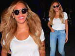 Beyonce was spotted looking smoking hot in a super casual outfit, while in NYC on Monday. The songstress was spotted leaving her office building with a huge smile on her face. She dressed down, but still looked as hot as ever. She wore a white tee, blue jeans and converse sneakers as she hit the streets in the early evening. \n\nPictured: Beyonce\nRef: SPL1076754  130715  \nPicture by: 247PAPS.TV / Splash News\n\nSplash News and Pictures\nLos Angeles: 310-821-2666\nNew York: 212-619-2666\nLondon: 870-934-2666\nphotodesk@splashnews.com\n
