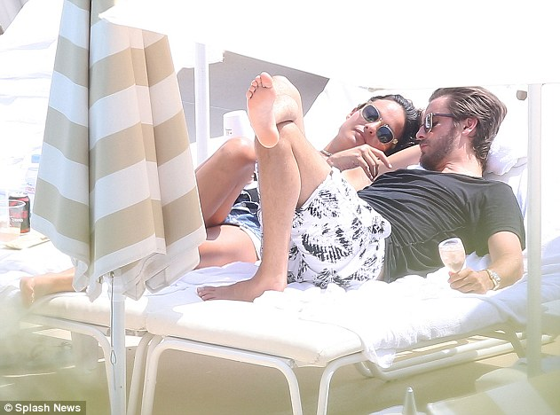 Snuggling on a sun lounger: The 32-year-old baby-daddy's on/off nine-year relationship with the 36-year-old reality star collapsed after photos emerged of him canoodling with stylist Chloé Bartoli in Monaco