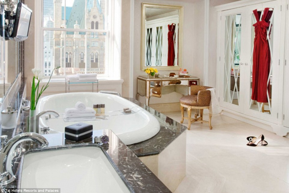 Lazing around: Sundays would be perfect lying in this marble bath on a marble podium looking out over the city