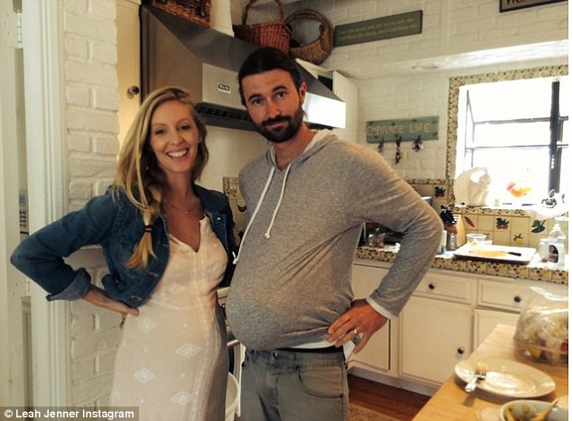 Humour: The couple shared an Instagram image of her husband mimicking her bump by shoving a ball inside his sweatshirt