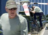 Picture Shows: Harrison Ford  July 12, 2015    'Star Wars' actor Harrison Ford stops to double check his helicopter before taking flight at the Santa Monica Airport in Santa Monica, California.     Harrison is back to his old self after his plane crash in March and made his first public appearance since the crash on Friday at San Diego's Comic-Con. He delighted fans with a surprise visit to the 'Star Wars: The Force Awakens' panel.    Exclusive All Rounder  UK RIGHTS ONLY  FameFlynet UK © 2015  Tel : +44 (0)20 3551 5049  Email : info@fameflynet.uk.com