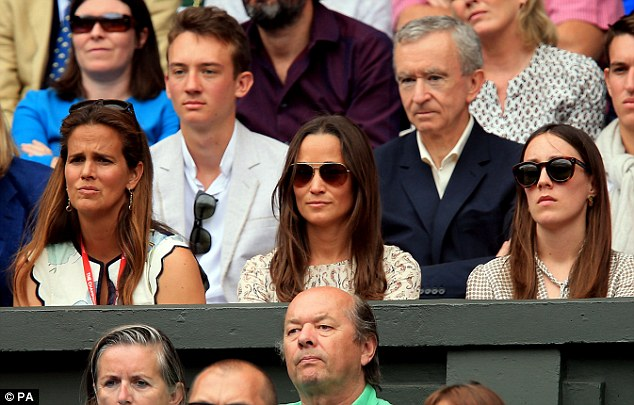 The trio showed off serious faces as they watched the nail-biting match between the tennis legends