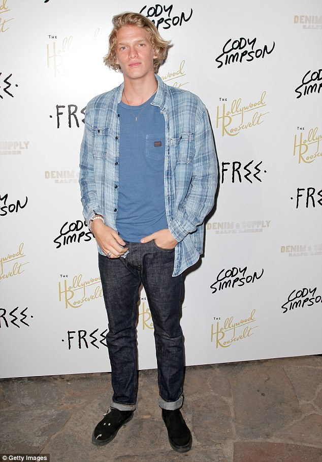 Black and blue: Cody wore a blue T-shirt and button up combo, completing his look with a pair of jeans and black Vans