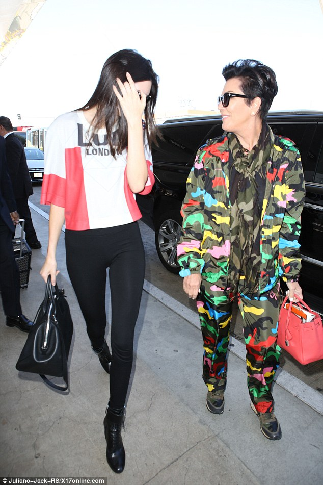 Blending in: The momager covered her eyes in large dark glasses as she made her way through the airport concourse