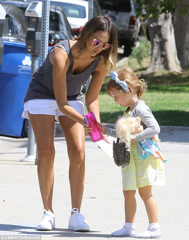 Hot mama! Alba showed off her toned legs in her summery white shorts