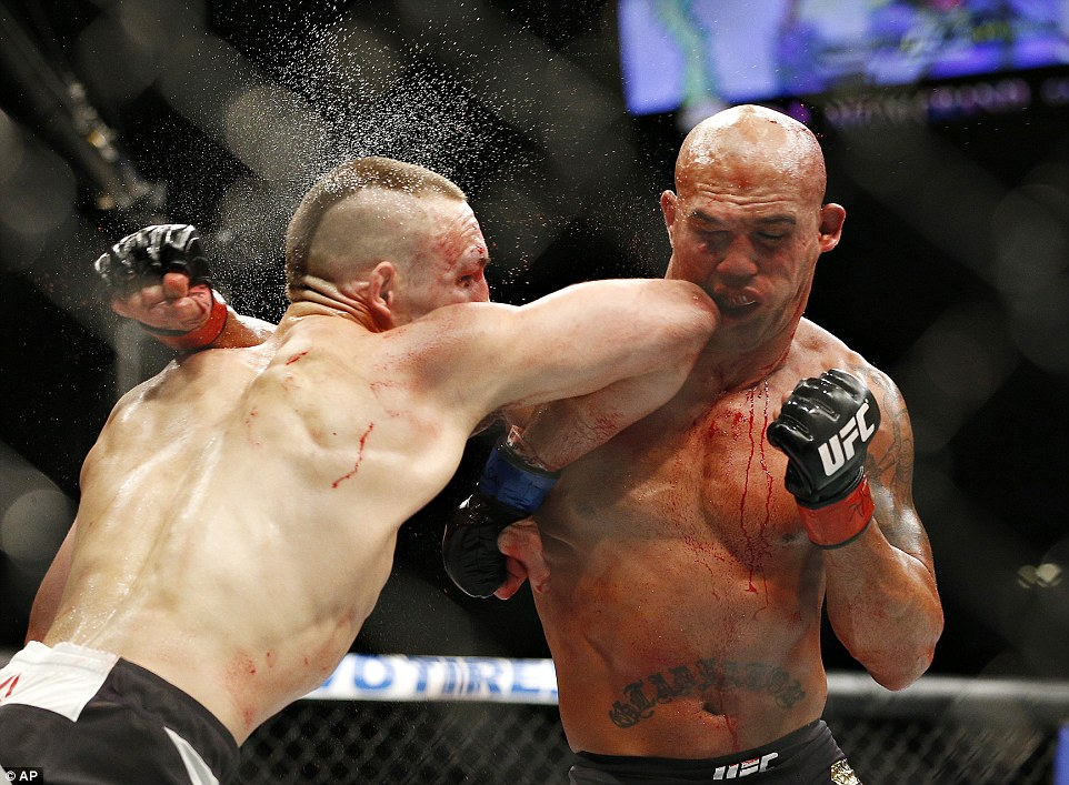 MacDonald lands his elbow on Lawler's jaw but the challenger was unable to press home his advantage