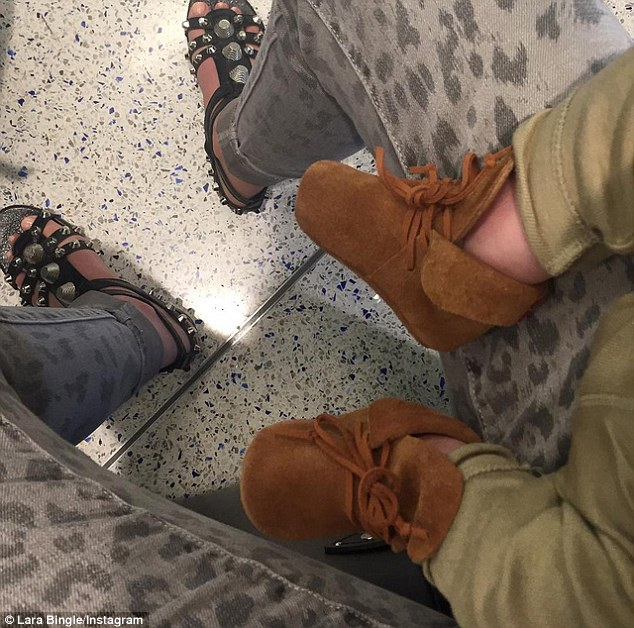 Cuties: The happy couple welcomed little Rocket in the world three months ago and Lara has since shared cute snaps of his baby booties and hands