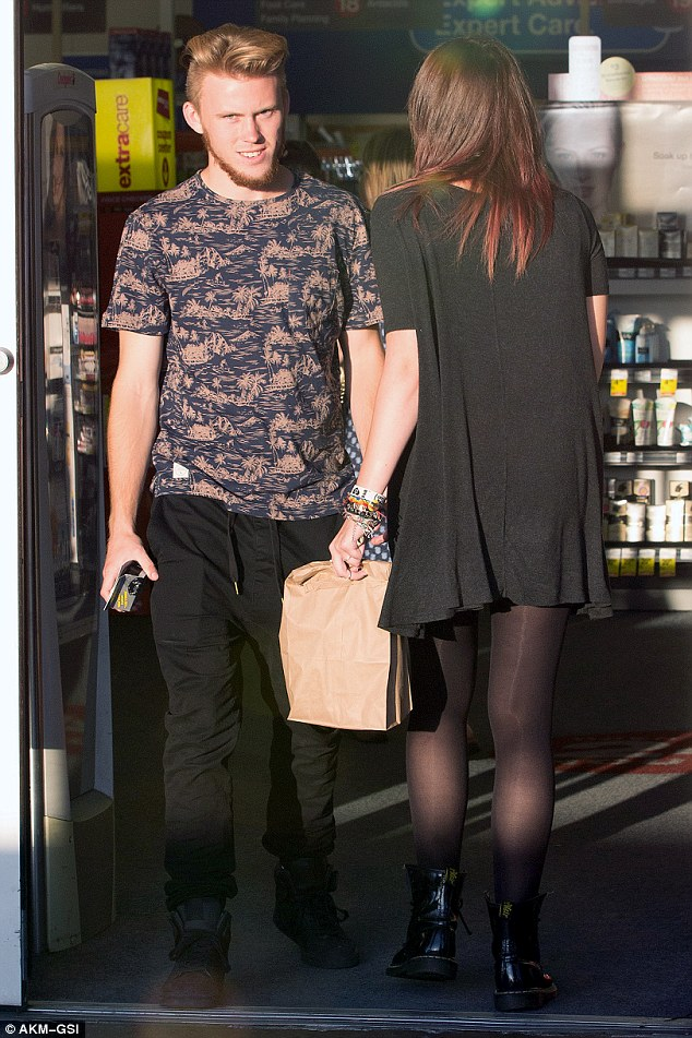 Strength to strength: Paris and Chester Castellaw dined out on sushi before heading into a nearby shop
