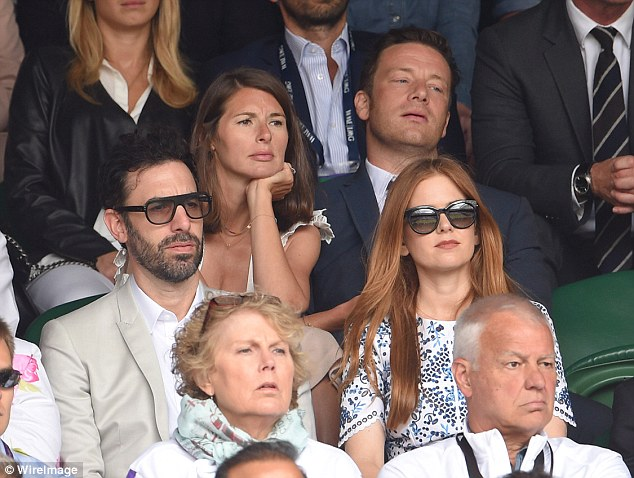 Hardly recognisable: Sacha Baron Cohen looked very much the English gent as he watched Novak Djokovic take on Roger Federer at the Men's singles finals of Wimbledon today