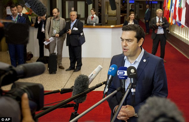 Backing down: Greek Prime Minister Alexis Tsipras agreed to rush key measures on tax hikes, pension reforms, and a debt repayment fund through parliament