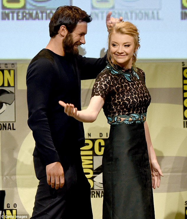 Having a laugh: The beautiful blonde joked around with co-star Clive Standen, who was decked out in black