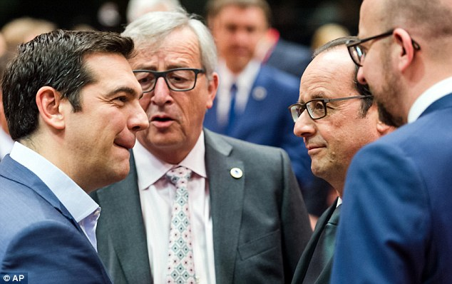 'Grexit has gone': European Commission President Jean-Claude Juncker (centre) said there was no longer any risk of Greece crashing out of the euro after Greek PM Alexis Tsipras (left) agreed the bailout deal