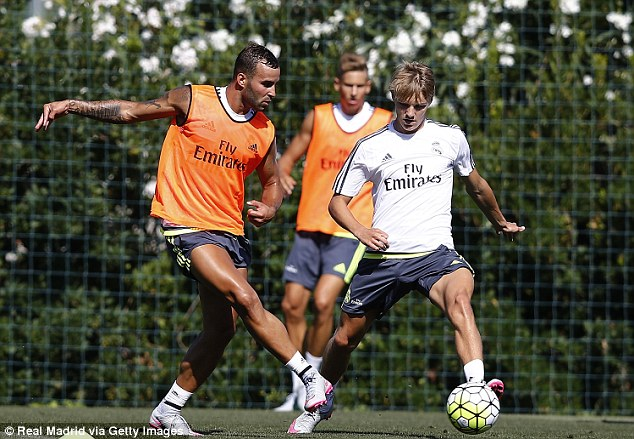 Jese Rodriguez (left) prepares to challenge Martin Odegaard (right) during Madrid's training session