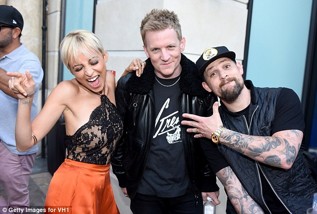 Together: A few days earlier, Richie and Madden, also wearing his wedding ring, along with Joel's brother Josh Madden, appeared at the pop-up store together to promote season two of the VH1 series Candidly Nicole