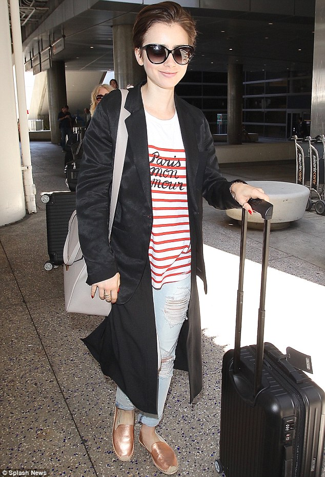 She's back! Lily Collins  touched down in Los Angeles on Saturday having spent a week in France for Paris Couture Week