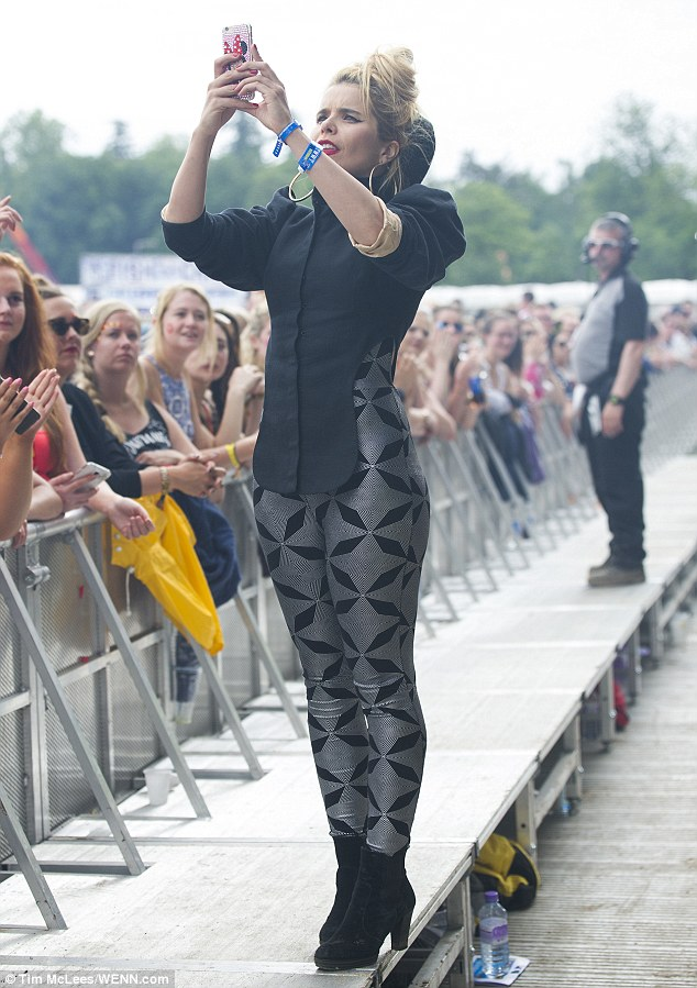 Careful: Even as she tried to take a picture of the crowd, Paloma looked to be teetering too close to the edge