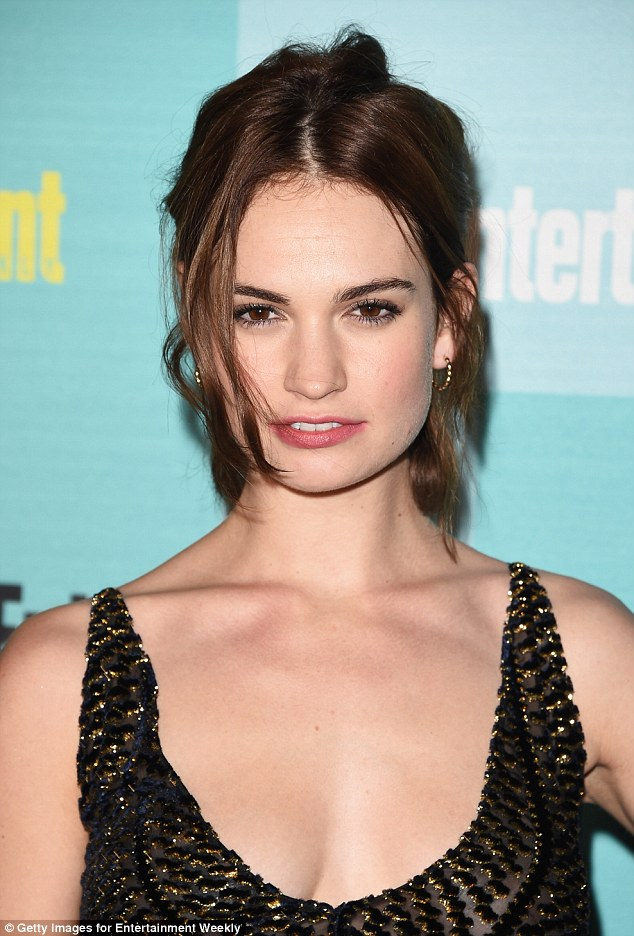 Stunning: She flashed a hint of her cleavage in the low-cut number which was heavily beaded