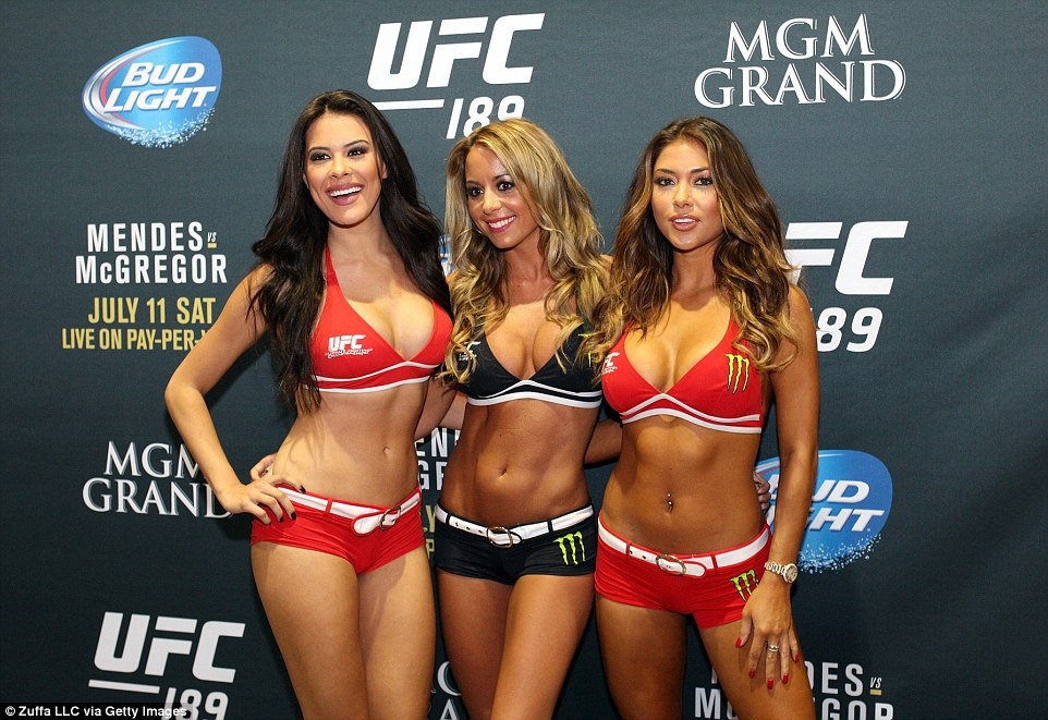 Octagon Girls Camila Oliveira, Carly Baker and Arianny Celeste pose before UFC 189 in Las Vegas
