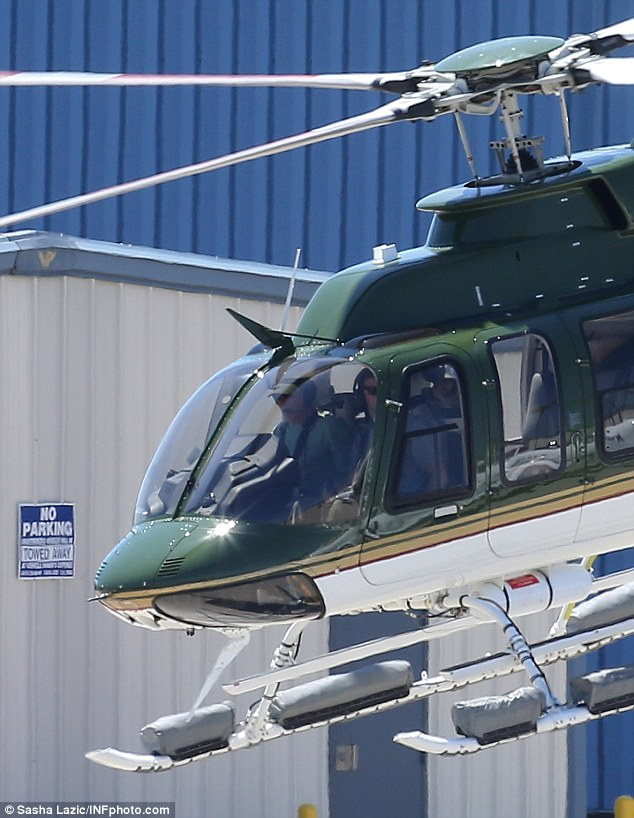 Two for take off: Harrison spotted in the right seat of his Bell helicopter with a co-pilot in the left seat as they lift off from Santa Monica Airport