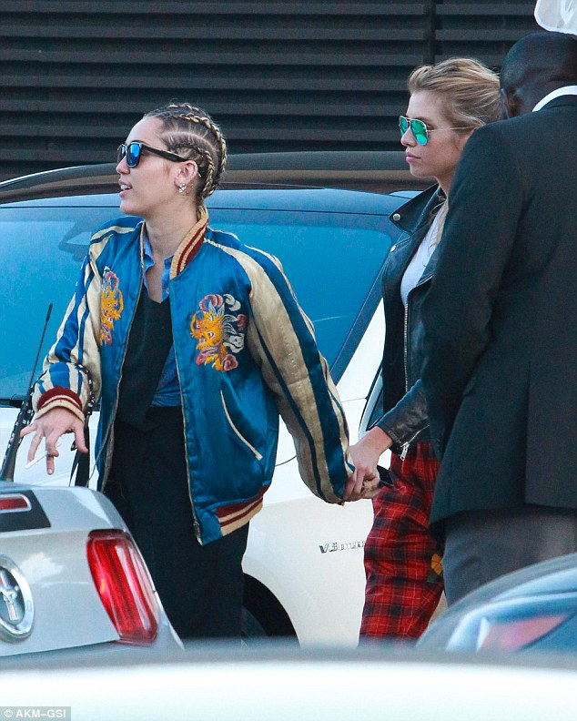 Hand in hand! Miley Cyrus and her rumoured girlfriend Stella Maxwell arrived to Nobu Malibu on Saturday