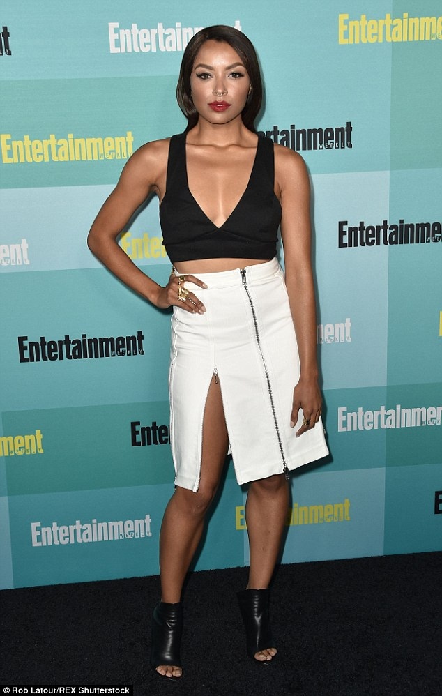 Stunning: Kat Graham showed off her hourglass figure in a sexy white zipper skirt and plunging black crop top