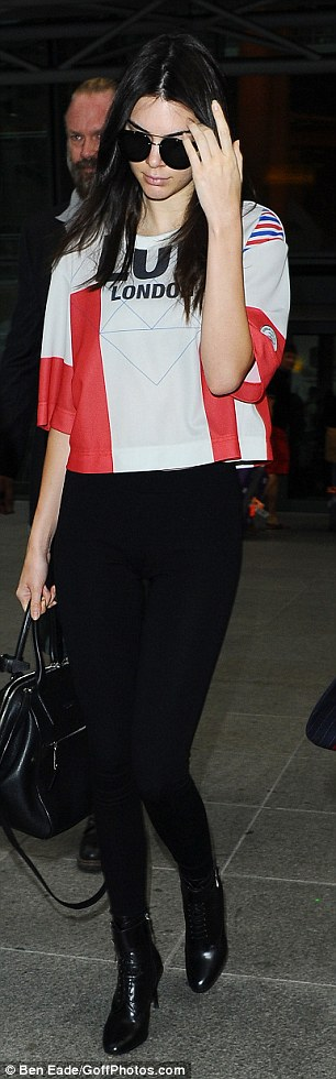 Working it: She hid her eyes behind a pair of very stylish designer sunglasses as she stepped outside