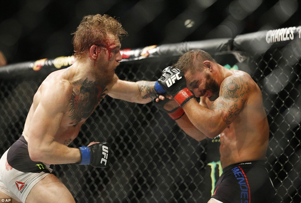 Despite suffering a cut to the side of the head, McGregor rained blows at Mendes, eventually claiming victory late in the second round