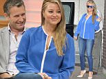 EDITORIAL USE ONLY. NO MERCHANDISING\nMandatory Credit: Photo by Ken McKay/ITV/REX Shutterstock (4902824q)\nAdam Hills and Holly Candy [Valance]\n'Good Morning Britain' TV Programme, London, Britain. - 14 Jul 2015\n\n