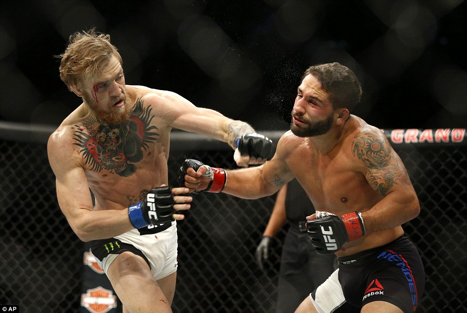 McGregor renders Mendes defenceless with a left as he closed in on victory in the second round of the contest in Las Vegas