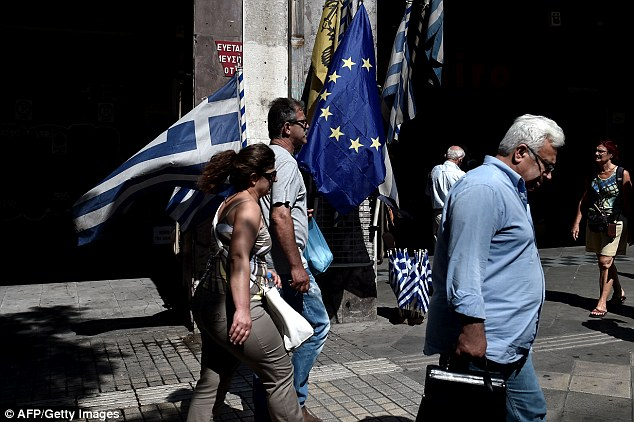 Dejected: Greeks greeted news of a deal with creditors with a measure of relief mixed with much anger, particularly at Germany, after it became clear Greece will have to swallow yet more austerity