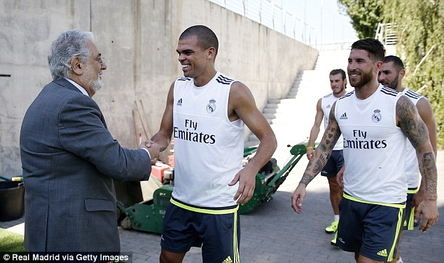 Opera singer and Real Madrid fanPlacido Domingo (left) made a visit to the Real squad's training session
