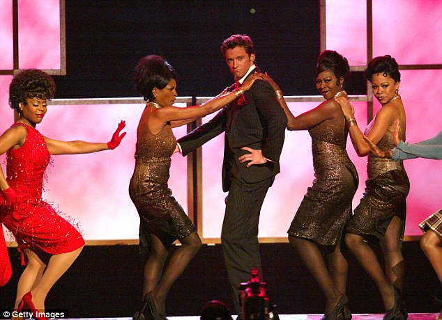 He's got the chops! Hugh on stage with cast members from the Broadway musical Hairspray in 2004