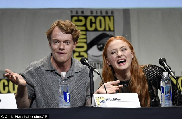 Laugh out loud: Sophie, who plays Sansa Stark, laughed and joked with her colleagues (Alfie Allen pictured left) on the panel as they fielded questions from the audience
