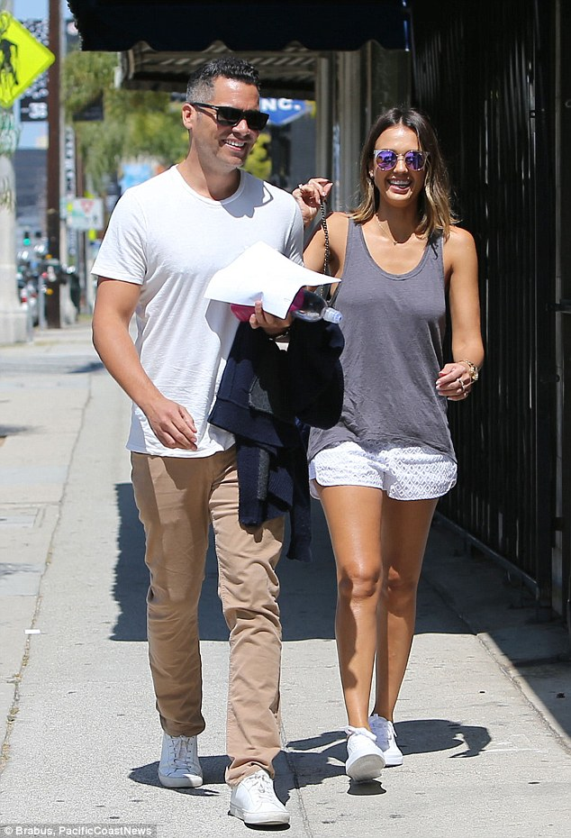 Summer lovin': The couple were clearly in high spirits when they stepped out into the sunshine
