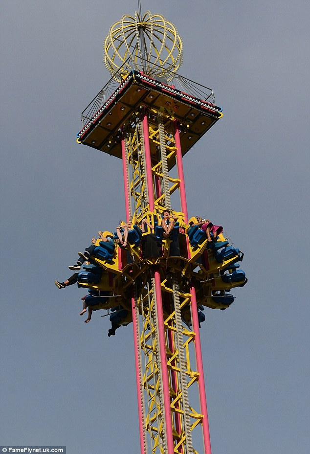 Coming down: The riders screamed out loud as they dropped like a stone from the top of the ride