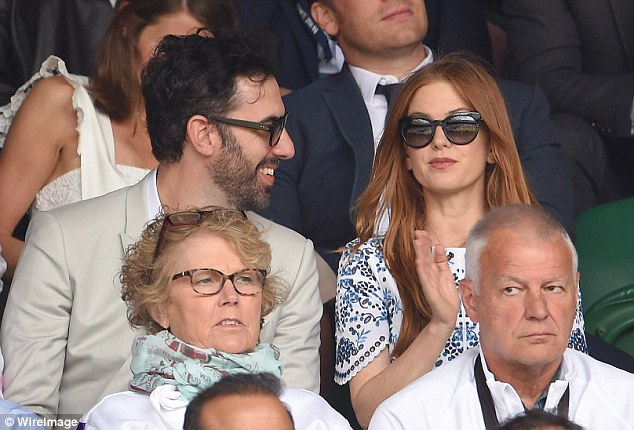 Tennis date: It was a rare public outing for Sacha and his wife Isla Fisher
