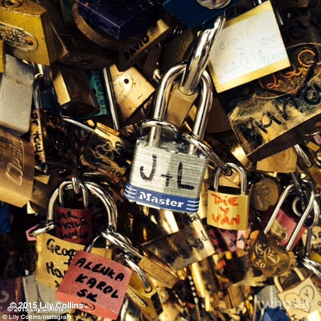 Loved-up: While Lily may have been living the high life it was clear she was pining for her 26-year-old actor boyfriend Jamie Campbell Bower. The star paid the love lock bridge a visit during her stay and managed to dig out a padlock with 'J + L' written on it in marker pen
