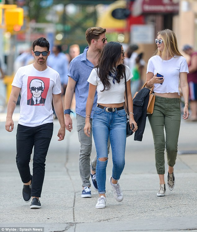 Group outing: Earlier in the day, Gigi and Joe headed out with their pal Leah McCarthy and a male friend