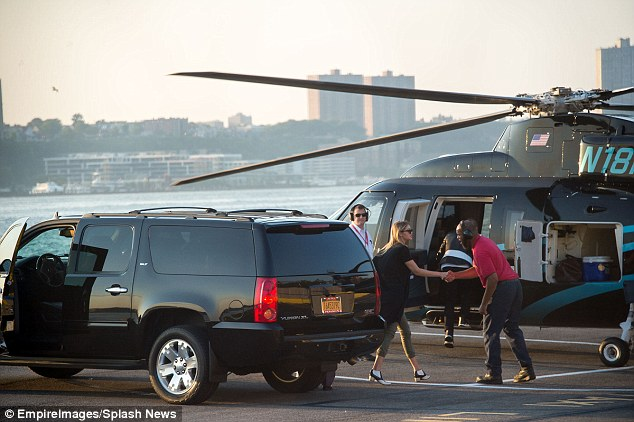Jetting off: Gigi, Joe and Nick Jonas were seen taking a helicopter from a New York heliport