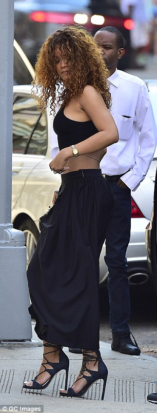 Earlier that day: Rihanna was spotted in another crop top