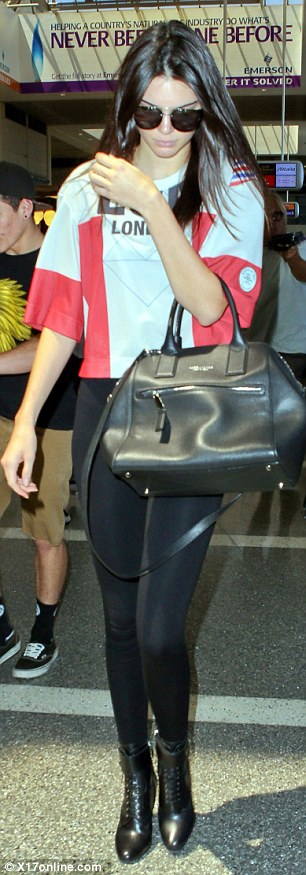 Casual: Kendall was rocking a sports style jersey with a pair of skinny black trousers