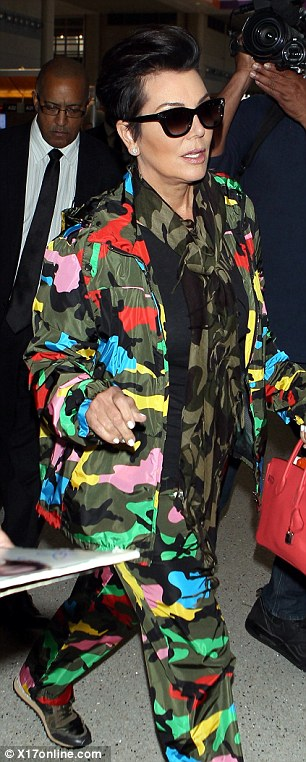 Going incognito? Kris' camouflage print ensemble had the opposite effect